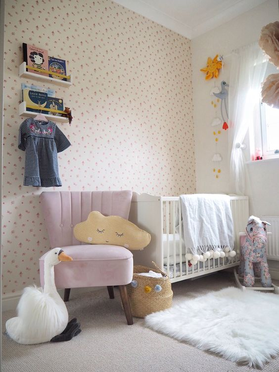 Pink Armchair Beside Baby Cots In The